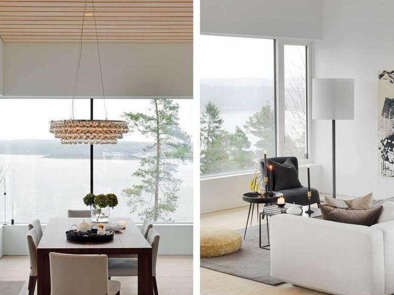 KASTER GLANS: Lampen lyser ned på bordet med brede planker i mørkt tre. Store glassflater ned mot fjorden gir en fantastisk utsikt. FOTO: Studio Dreyer Hensley